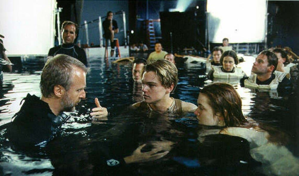 Director James Cameron giving directions to Leo and Kate on the set of The Titanic (1997)